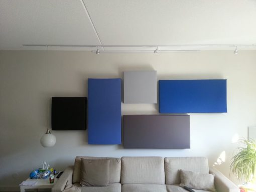 GIK Acoustics 242 Acoustic Panels in different colors and shapes above a couch