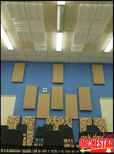 Rock Island Orchestra using GIK Acoustics Monster Bass Traps, Alpha Series Freestanding Bass Traps and GridFusors on the ceiling for diffusion
