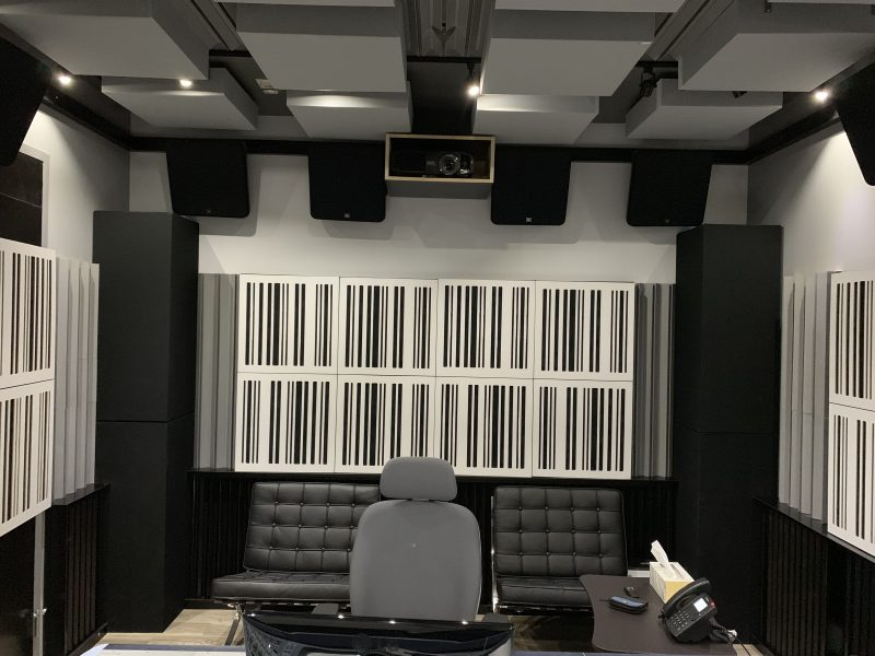 GIK Acoustics Alpha Series 1D in black with white plate in studio on back wall