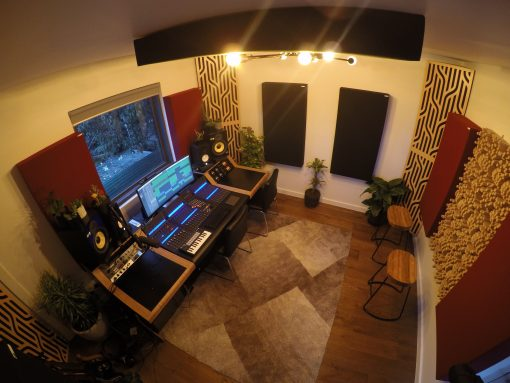Home Studio with Impression Pro Series corner Bass Traps in Braids pattern in blonde veneer stacked in corners and gotham diffusors on back wall