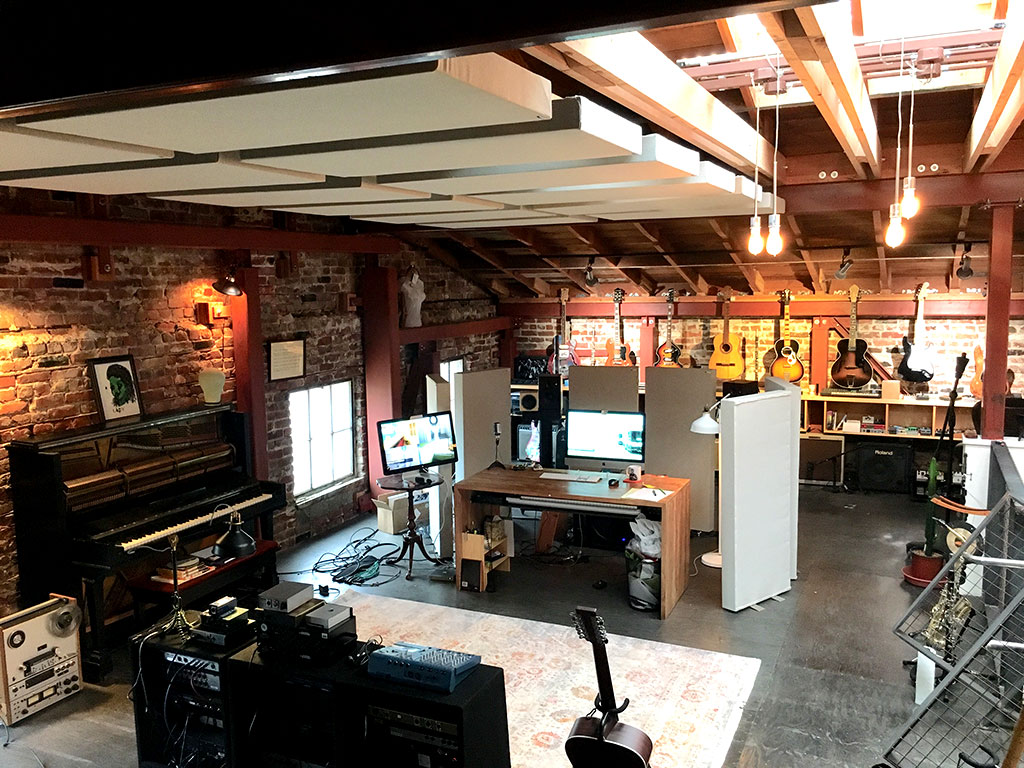 Home recording studio with GIK Acoustics freestand free stand acoustic panels and hanging ceiling clouds photo Jake Bloomfield-misrach