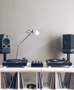 GIK Acoustics TriTrap Corner Bass Traps with turntables and records with speakers